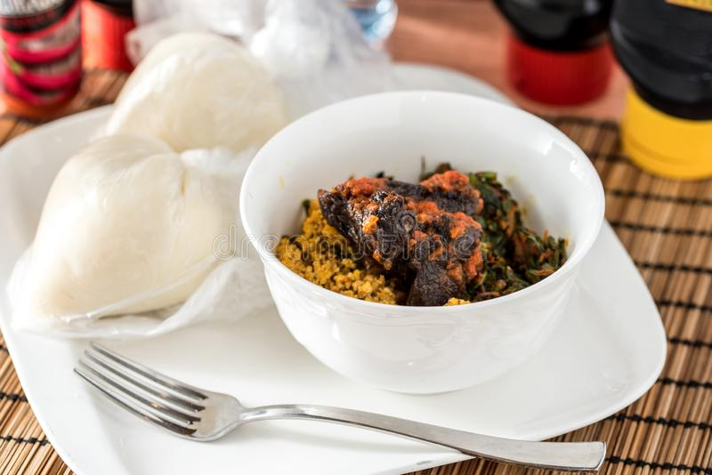 Regional African Food. On white plate on wooden background royalty free stock photos