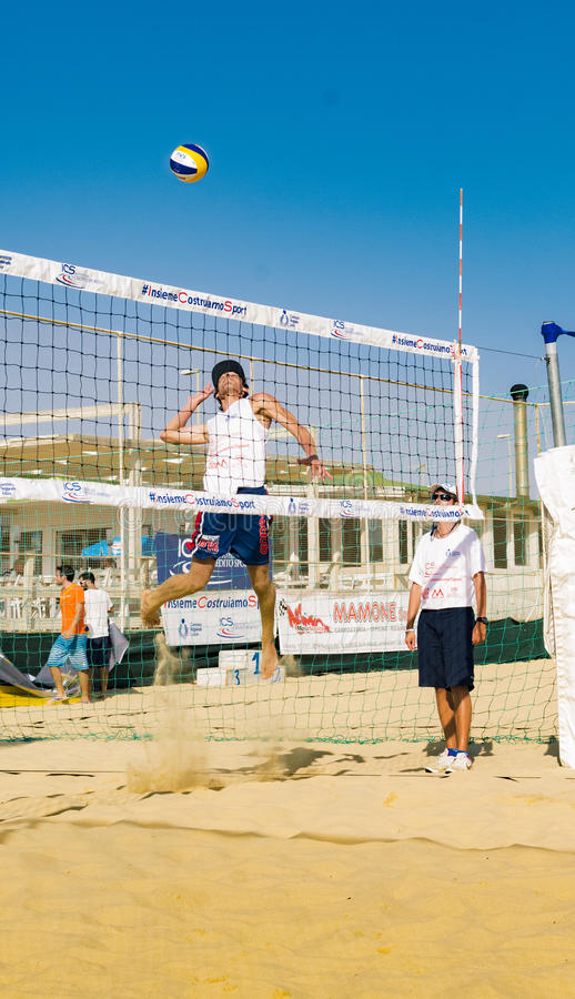 Regional beach volleyball tournament. Collision in the penalty while competing victory point to the sea with the participation of the band rum by presenting royalty free stock photography