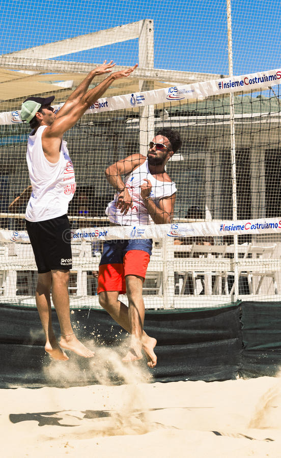 Regional beach volleyball tournament. Collision in the penalty while competing victory point to the sea with the participation of the band rum by presenting royalty free stock images