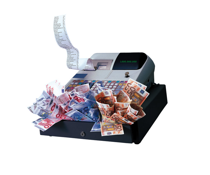Register Machine and Euros. Register Machine with euro notes over white background - devaluation and inflation global crisis royalty free stock image