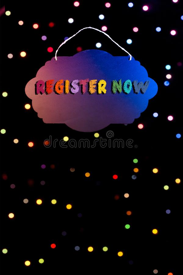 Register now wording written on sign board  in hand stock illustration