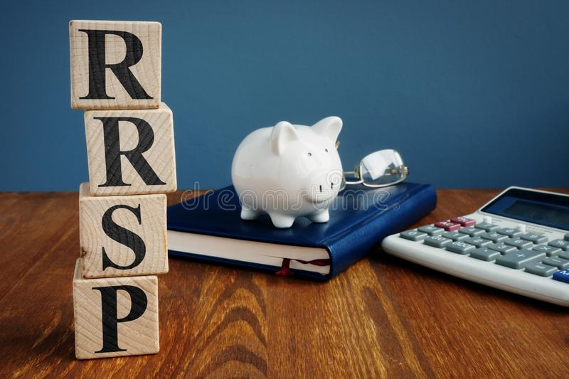 Registered retirement savings plan RRSP or RSP. And piggy bank stock photos