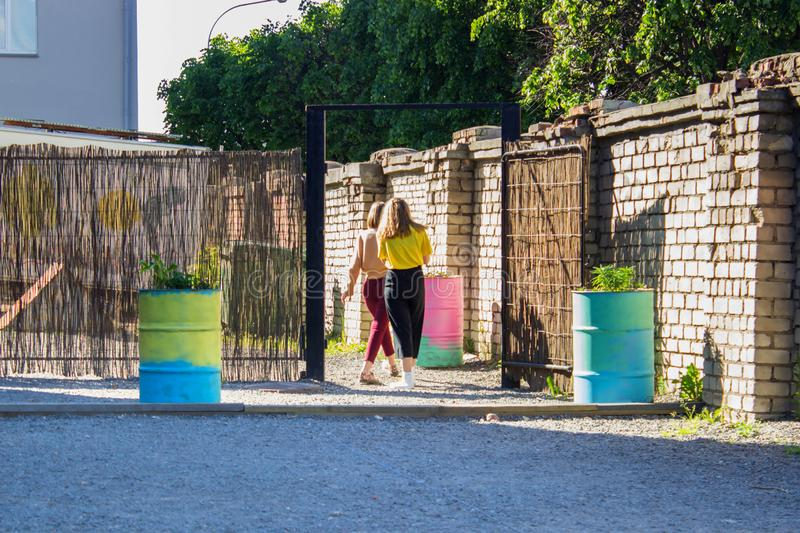 Registration of yard space in the city. Cheap ways to decorate the urban student site. Relaxation area decorated with barrels of flowers stock photography