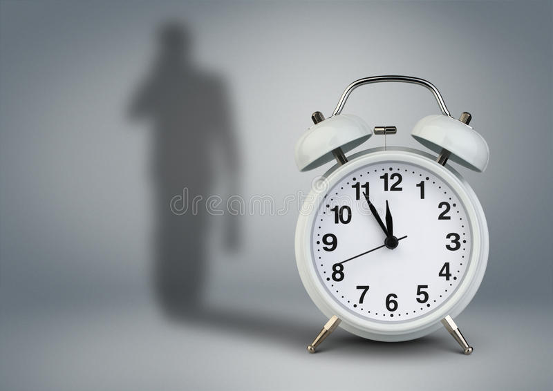 Registre con la sombra del hombre de negocios, concepto de la gestión de tiempo fotos de archivo
