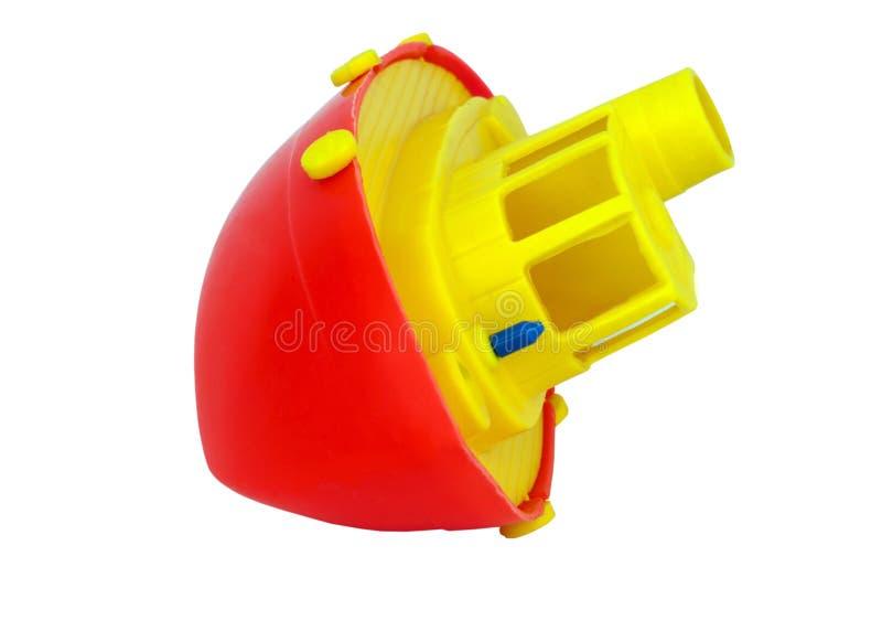 Registrierung von rotem und gelbem Toy Boat stockfotografie