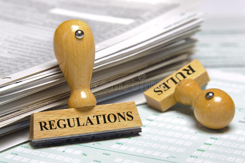 Reglas y regulaciones imagen de archivo