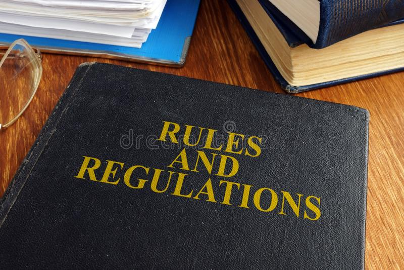 Regler och reglementet bokar arkivbild