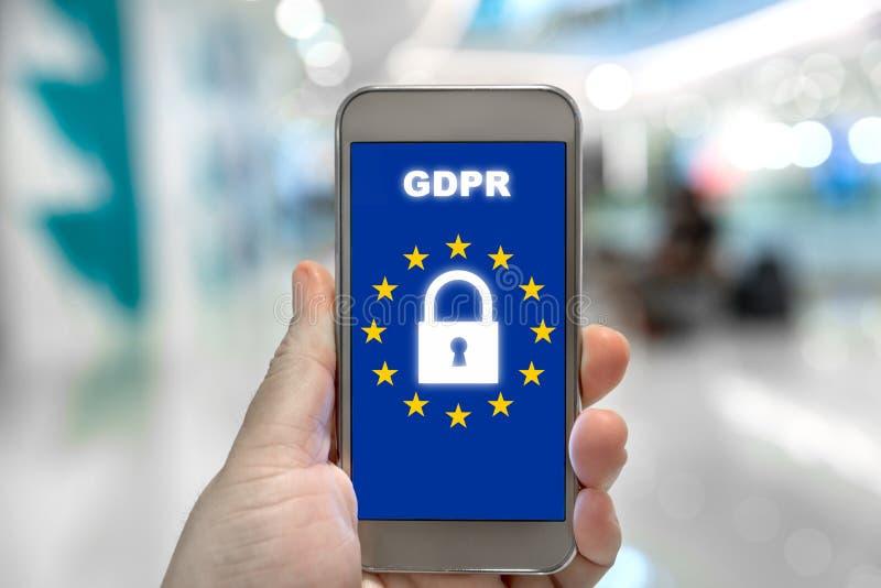 Reglering GDPR för skydd för allmänna data på mobiltelefonen Cyber fotografering för bildbyråer