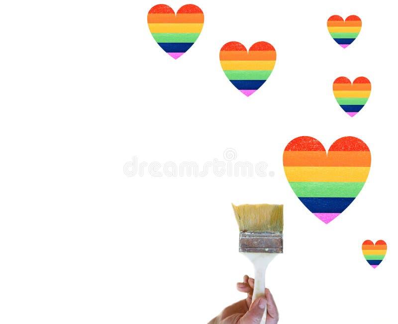 Regnbåge - form Lgbt-rättighetskoncept Hand målar ett hjärta som en HBT-flagga isolerad på vit bakgrund royaltyfri fotografi