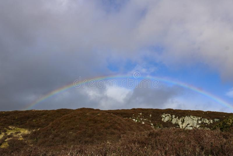 Regnbåge i skyen royaltyfri foto
