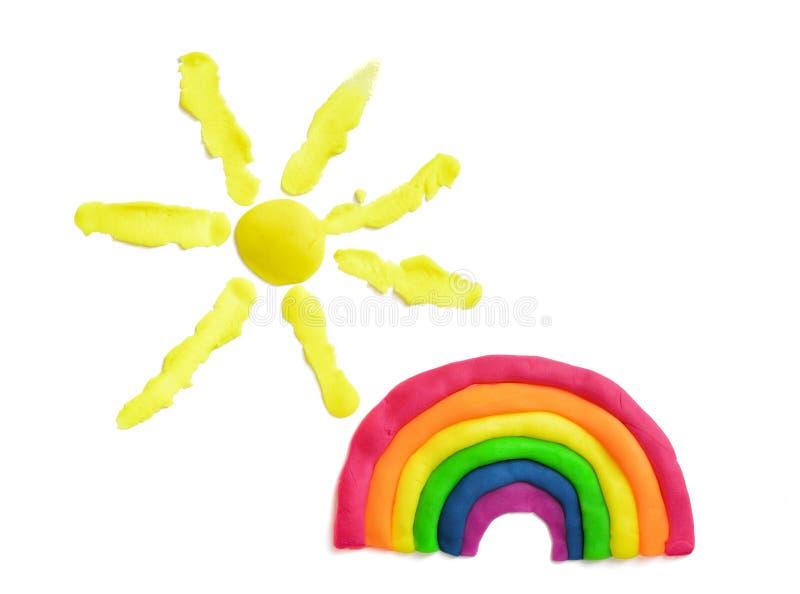 Regnbåge och sol som göras av mångfärgad plasticine royaltyfri bild