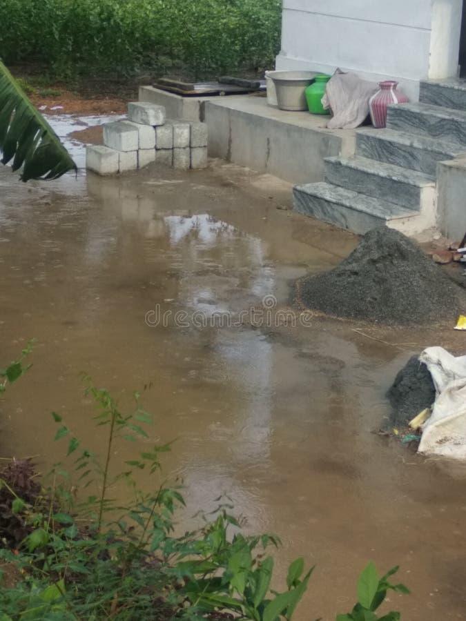 Regnet av byn royaltyfri foto