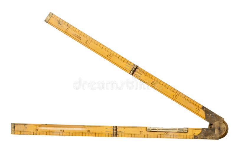 Regola di piegatura del carpentiere di diciannovesimo secolo con il livello d'ottone immagine stock