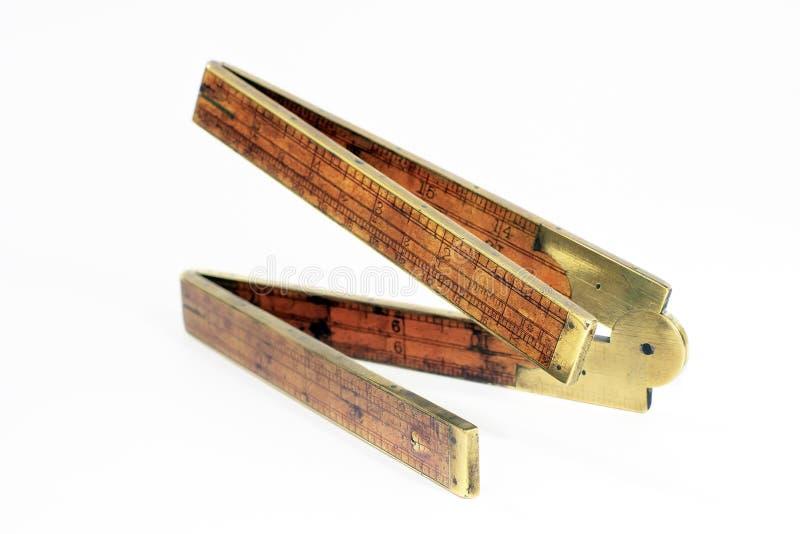Regola di piegatura del legno di bosso del carpentiere antico di diciannovesimo secolo fotografia stock libera da diritti
