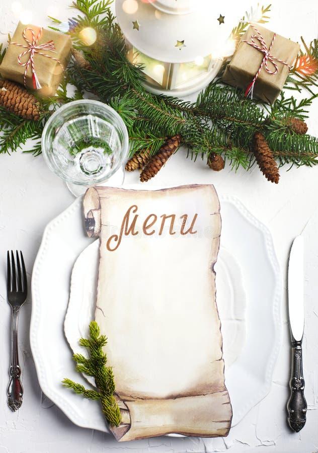 Regolazione di posto di Natale con la carta in bianco per la scrittura del menu di Natale immagini stock libere da diritti