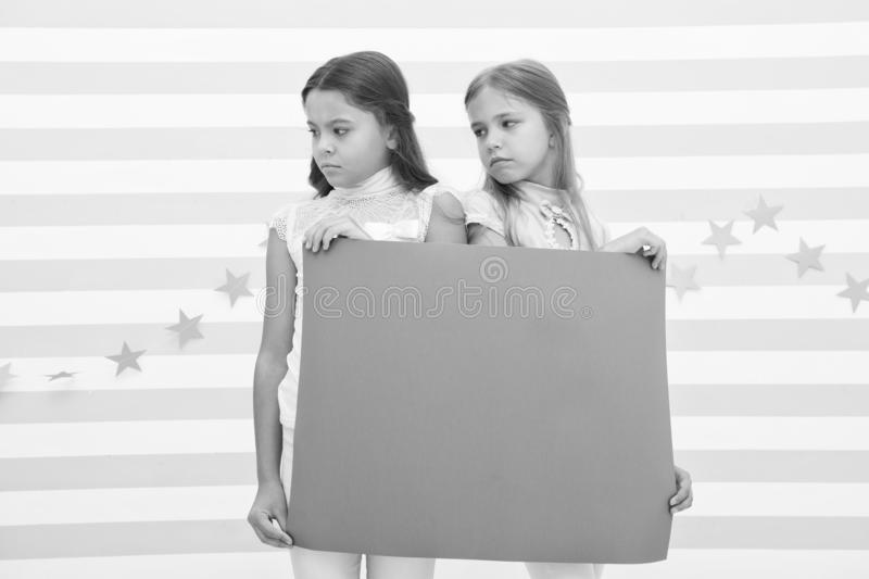 Regret to inform you. Girls hold advertisement poster copy space. Children hold advertising banner. Sad kids with blank. Paper advertisement. Advertisement royalty free stock photos