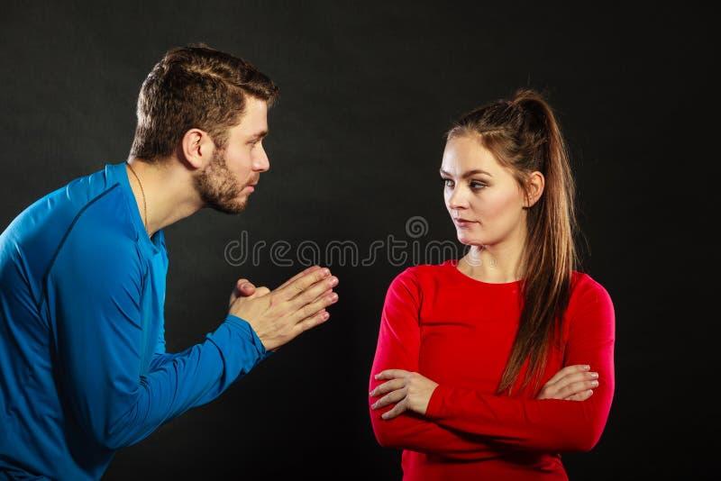 Regretful man husband apologizing upset woman wife stock photo