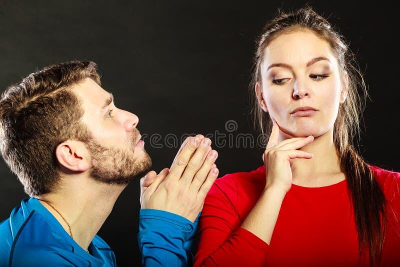Regretful man husband apologizing woman wife. royalty free stock photo