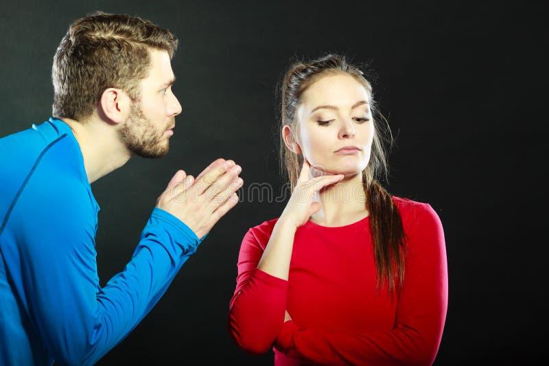 Regretful man husband apologizing woman wife. stock photo