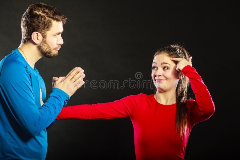 Regretful man husband apologizing woman wife. royalty free stock image