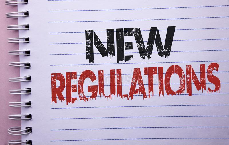 Regulamentos novos do texto da escrita da palavra O conceito do negócio para a mudança das leis ordena as especificações de padrõ foto de stock royalty free