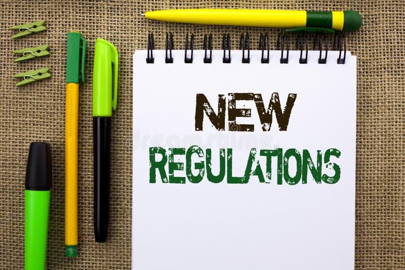 Regulamentos novos do texto da escrita da palavra O conceito do negócio para a mudança das leis ordena as especificações de padrõ fotografia de stock royalty free