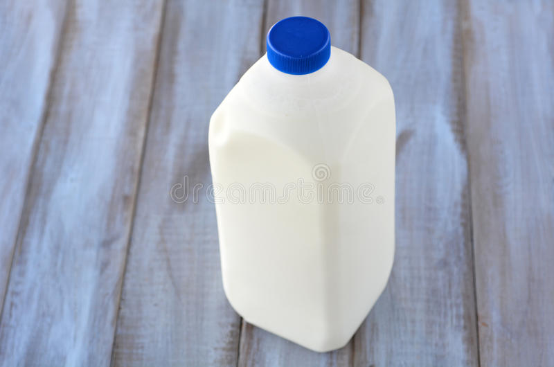 Regular bottle of gallon of cow milk royalty free stock photos
