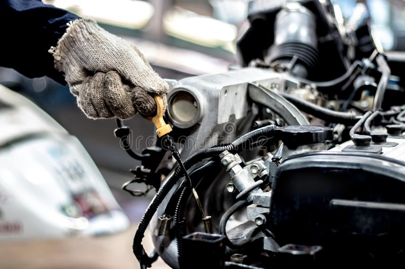Regular car care makes car use. Safe and confident in driving. Regular inspection of used cars. It is very well done. Such as oil check royalty free stock image