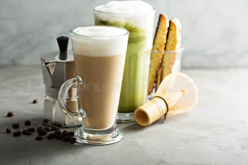Regular coffee and matcha latte. On light background stock image