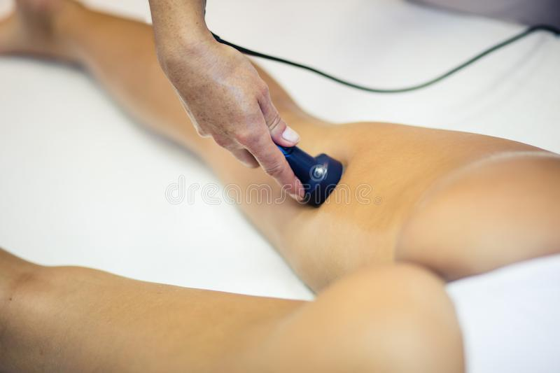 Regular control. Girl is having vacuum massage from a professional. Close up royalty free stock images