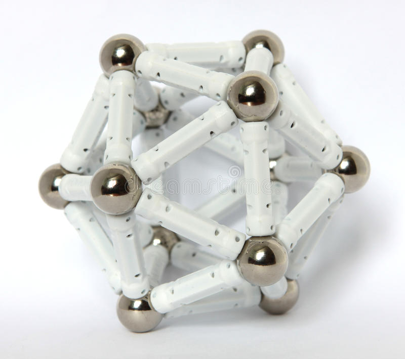A regular icosahedron. On the studio table stock photo