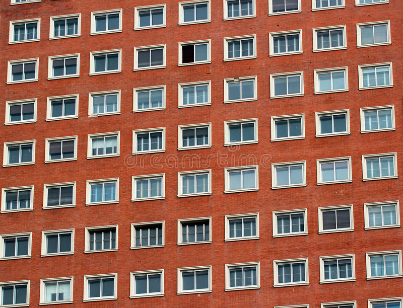Regular pattern of windows in a modern building.  stock photography
