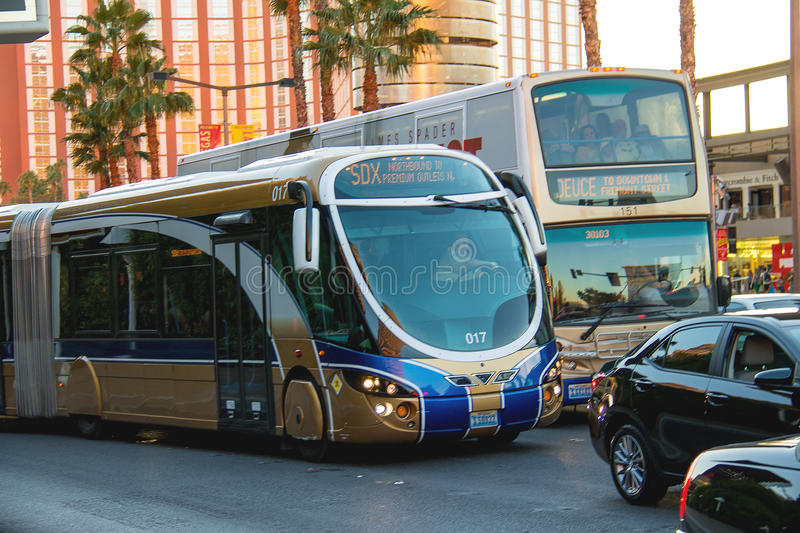 A regular and tourist buses in Las Vegas, Nevada. LAS VEGAS, NEVADA, USA - OCTOBER 25, 2013 : A regular and tourist buses in Las Vegas, Nevada. 40 million royalty free stock images