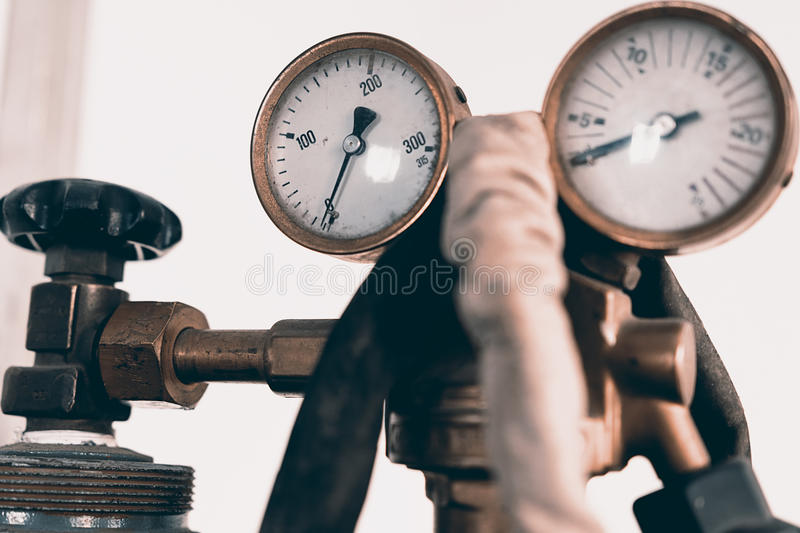 Regulator of pressure for gas welding stock photography