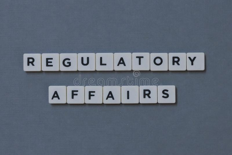 ' Regulatory Affairs ' word made of square letter word on grey background. Business, information, management, work, department, quality, policy stock images