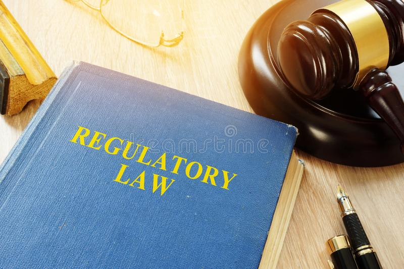 Regulatory law and gavel in a court. stock photos