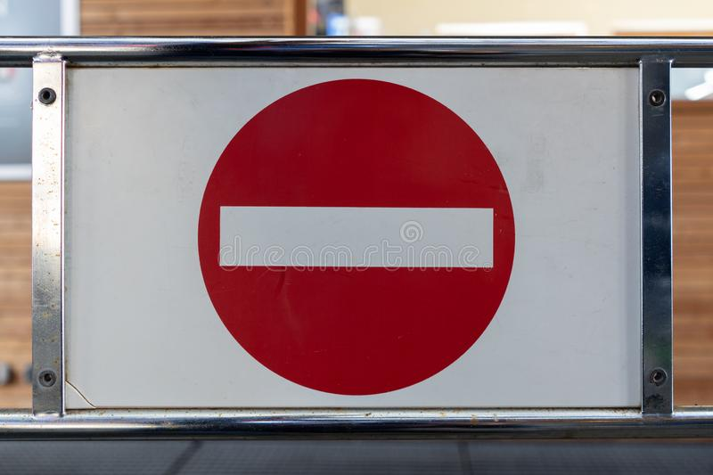 Regulatory sign `No Entry` on a barrier in a workshop Mounted on a frame royalty free stock photography