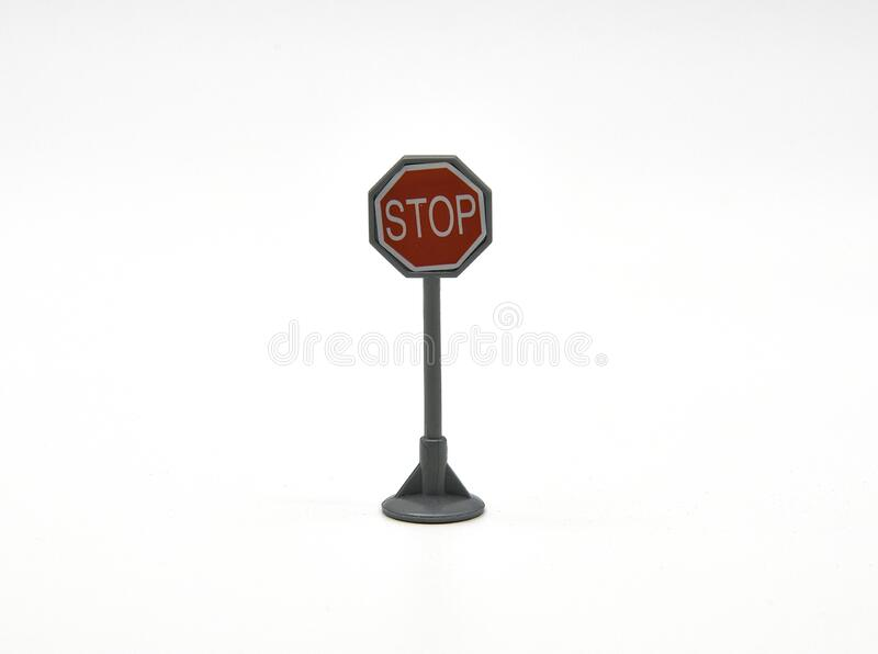 Regulatory traffic sign indicating at the intersections the obligation to stop before continuing the march. In its most widespread form around the world, it is stock photo