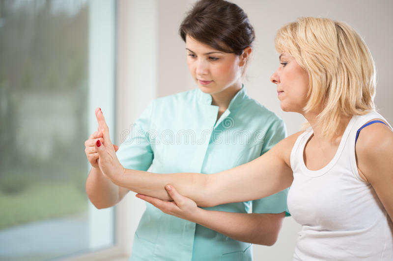 Rehabilitation after wrist injury stock images