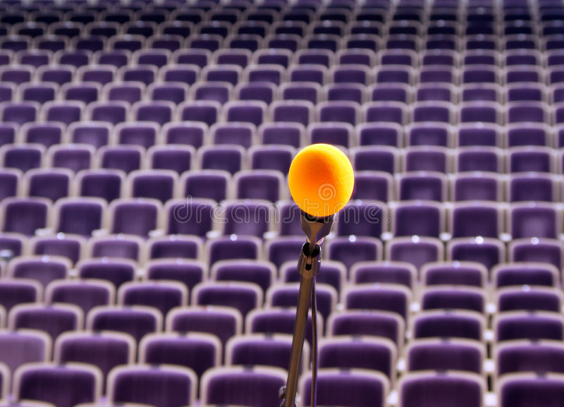 Rehearsal microphone on stage. Microphone on the stage and empty hall during the rehearsal royalty free stock images