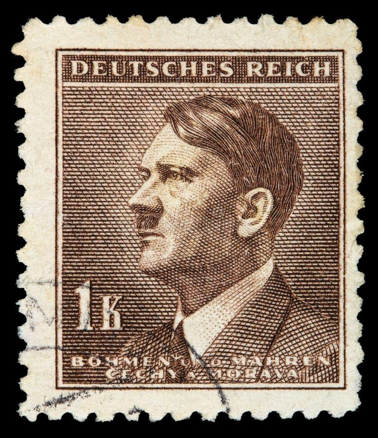 REICH ALEMÃO Cerca de 1939 - c 1944: Um selo postal com retratar de Adolf Hitler foto de stock royalty free
