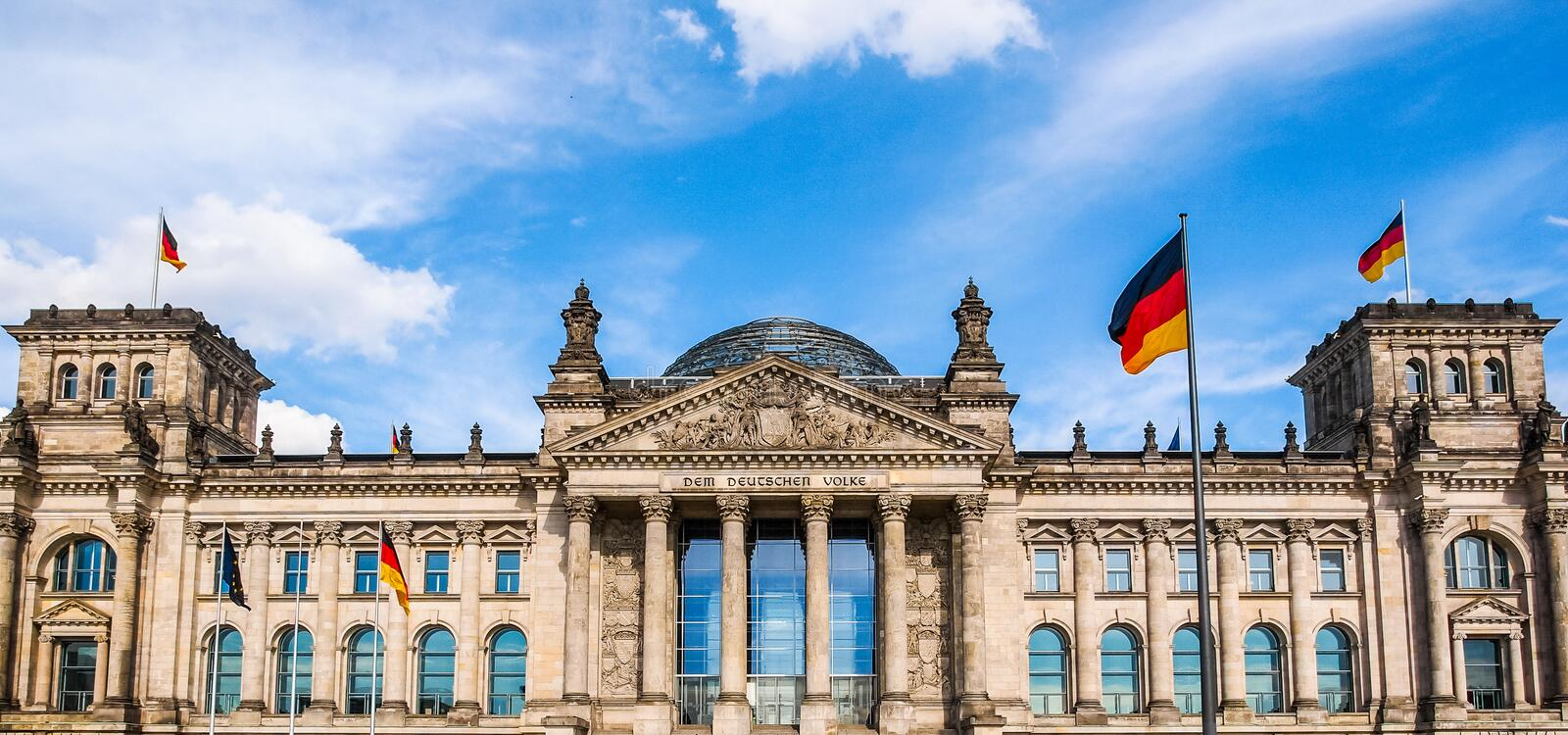 Reichstag in Berlin. Reichstag houses of parliament in Berlin, Germany - Dem Deutschen Volke means To The German People stock photo