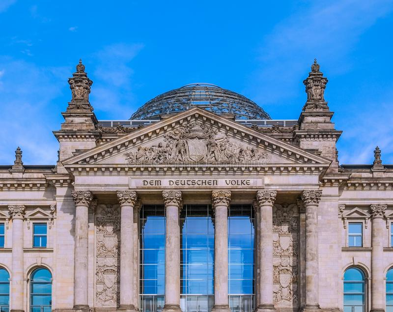 Reichstag in Berlin. Reichstag houses of parliament in Berlin, Germany - Dem Deutschen Volke means To The German People royalty free stock images
