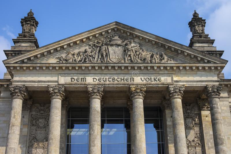 The Reichstag in Berlin. A view of the magnificent facade of the Reichstag parliament building in Berlin, Germany. The English translation of Dem Deutschen Volke royalty free stock photo