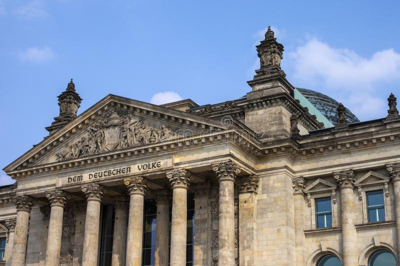 The Reichstag in Berlin. A view of the magnificent facade of the Reichstag parliament building in Berlin, Germany. The English translation of Dem Deutschen Volke royalty free stock photography