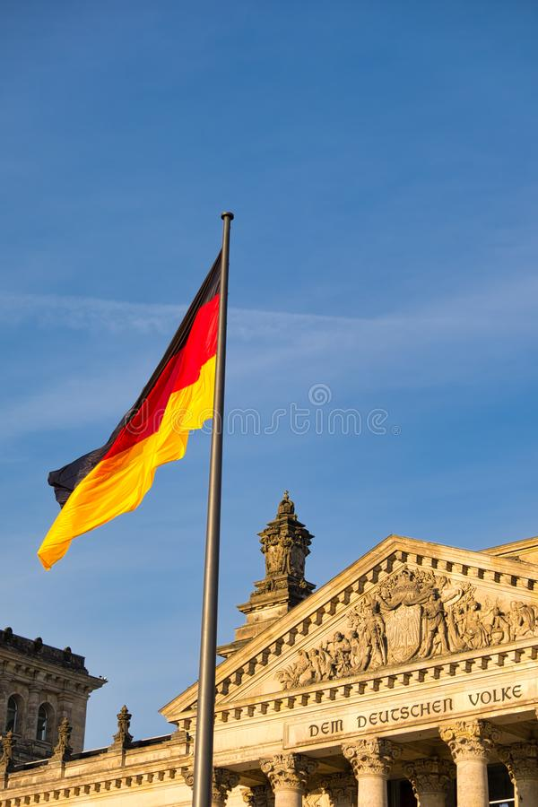 The Reichstag building in Berlin, Germany with the German flag. A famous landmark and travel destination stock photos