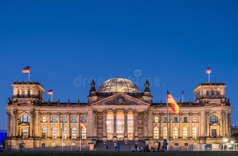 The Reichstag building, seat of the German Parliament Deutscher Bundestag, at night in Berlin royalty free stock photos