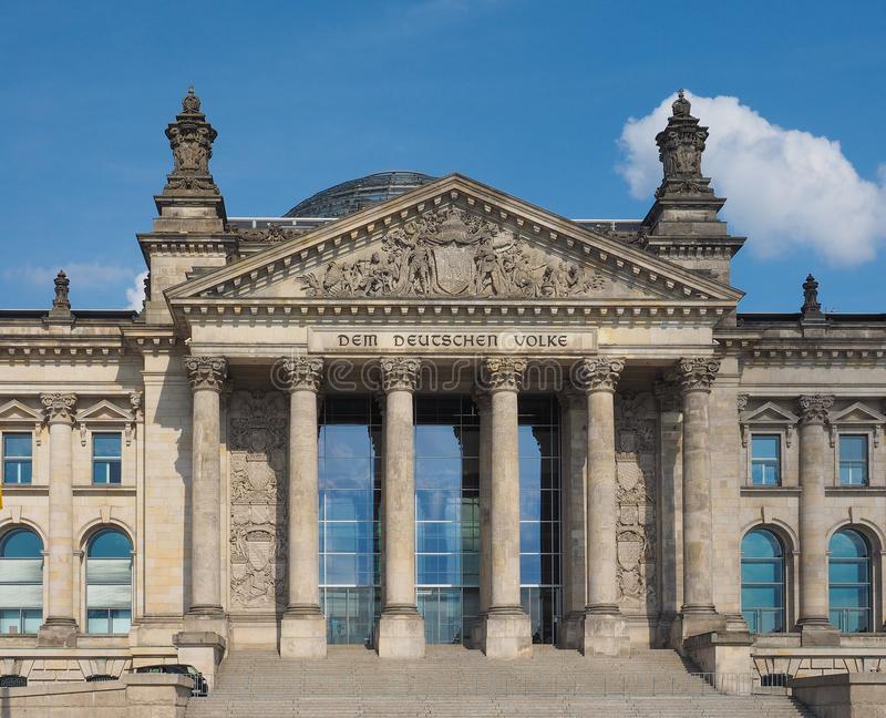 Reichstag in Berlin. Reichstag houses of parliament in Berlin, Germany - Dem Deutschen Volke means To The German People royalty free stock image