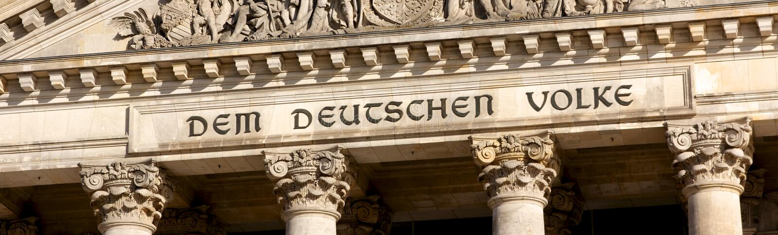 Reichstag Inscription in Berlin. Inscription Dem Deutschen Volke (to the German people) on the facade of the Reichstag, seat of the federal parliament in Berlin stock images