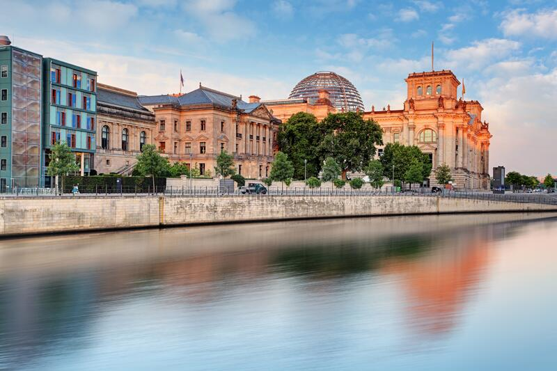 Reichstag with reflection in Spree, Berlin stock photos